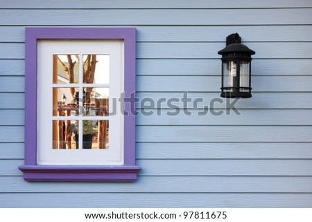 window and wood wall,European-style houses. - stock photo