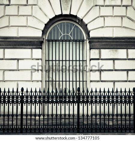 Window arch and bars in a London mansion - stock photo