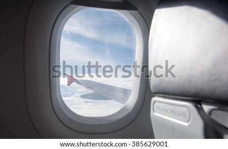 window at flying airplane - stock photo