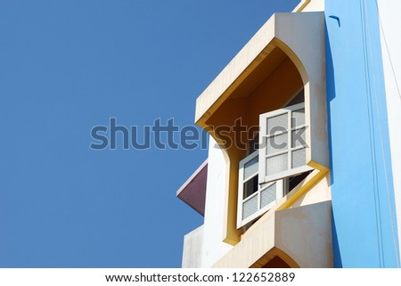 Window at the corner with blue sky