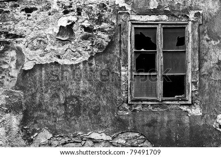 window at the old wall black and white - stock photo