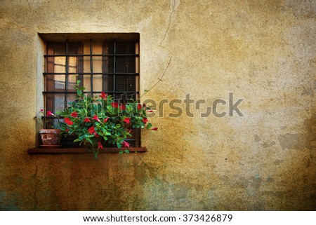 Window at the Pienza city wall, Italy, Tuscany. Romantic travel grunge floral background. - stock photo