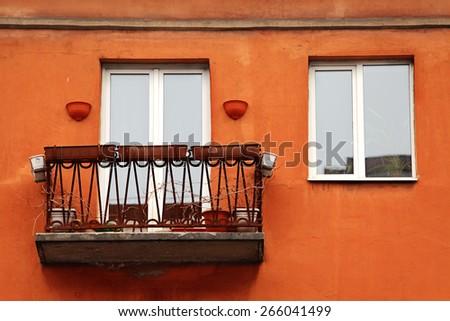 window balcony orange flower pot color paint - stock photo