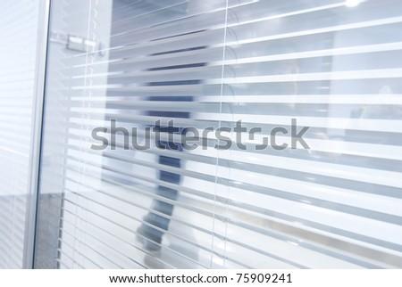 window blinds,business man - stock photo