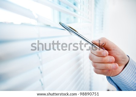 window blinds,business man - stock photo
