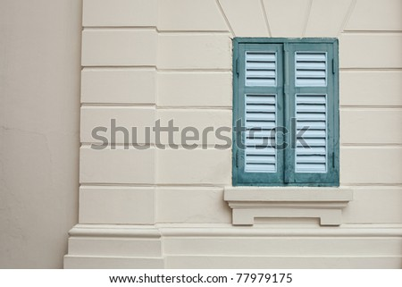 window classic on the wall. color green older window on the wall. - stock photo