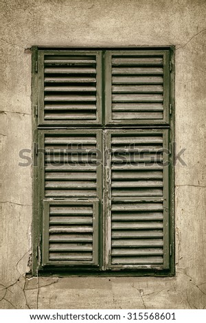 Window Closed with Green Wooden Shutters - stock photo