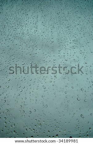 Window covered by rain drops (portrait orientation). - stock photo