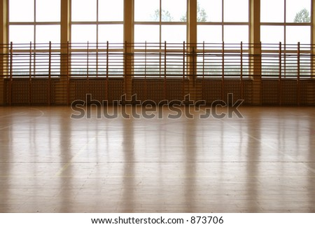 Window curtain wall reflecting at parquet floor at school gym. - stock photo