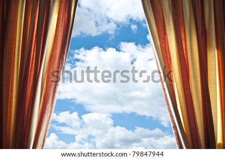 Window curtains with view of clouds and sky - stock photo