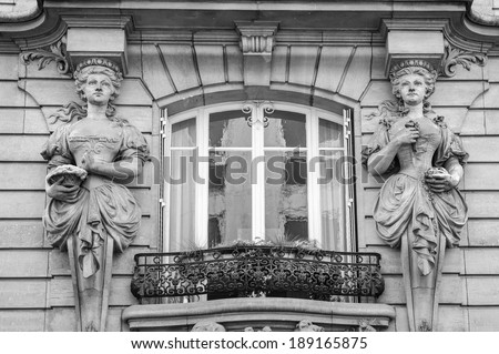Window decorated by statues in Paris, France - stock photo