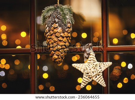 Window Decorated with Christmas ornaments - stock photo