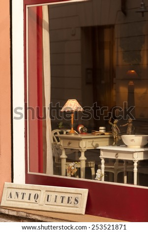 Window display of antiques shop in Verona, Italy - stock photo