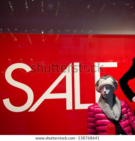 window display with text SALE in a shop - stock photo