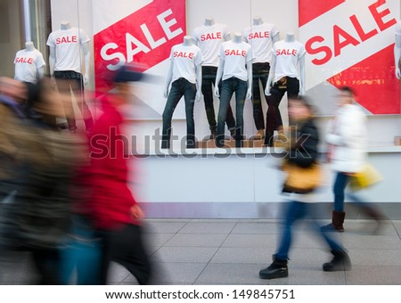 window display with text SALE in a shop. - stock photo