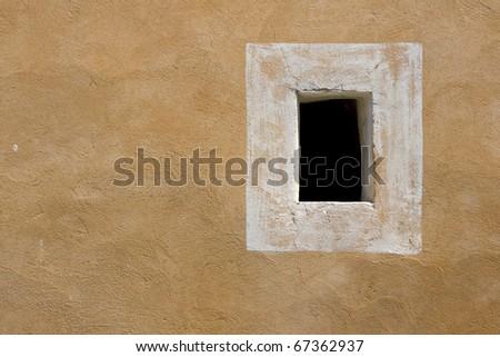 Window frame on wall, Provence. - stock photo