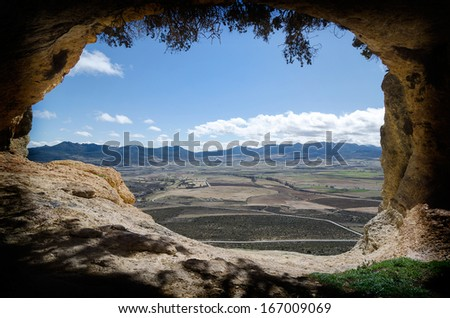 Window from a cave where you can see the fields of Moratalla in Murcia (Spain)