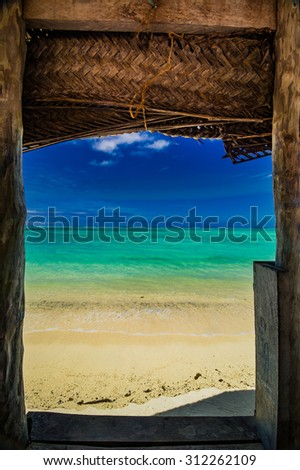 window from bungalow fale in samoa with a view to crystal blue ocean - stock photo
