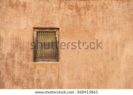 Window in a rustic stucco wall in an old building