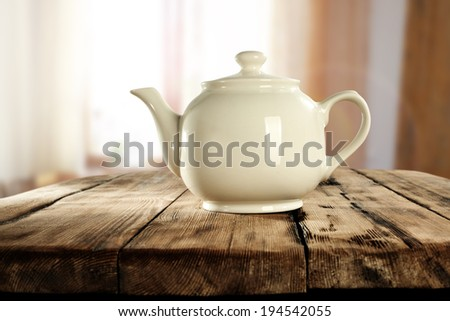 window in kitchen and teapot