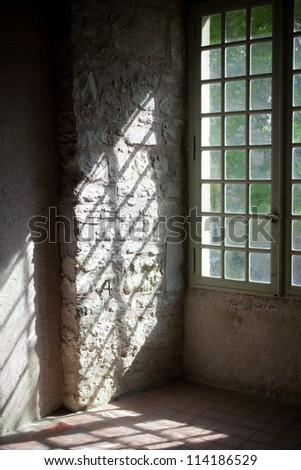 Window in old castle - stock photo