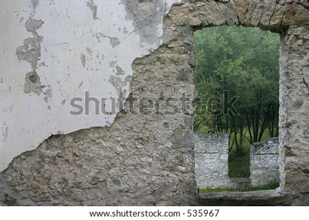 window in old ruined building - stock photo