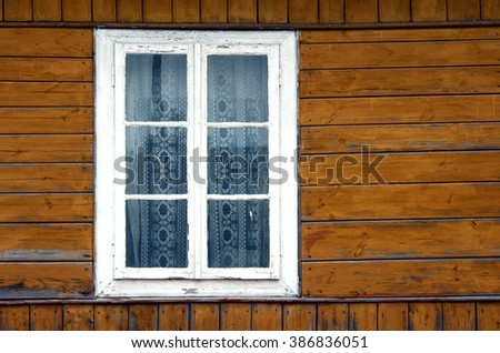 window in old, wooden house, Poland