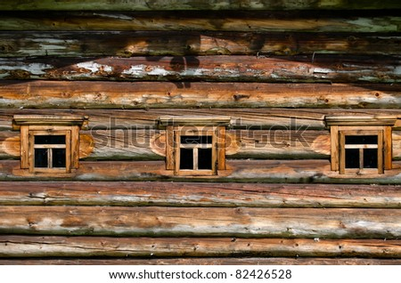 Window in the old wooden house close-up - stock photo