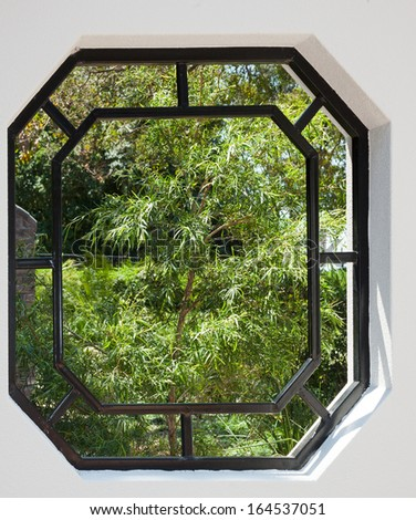 window in wall to a garden room - stock photo