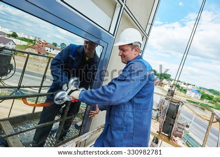 window installation. male industrial builder worker at facade glazing. - stock photo