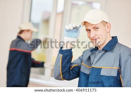window installation worker - stock photo