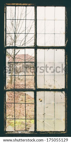 Window light in old abandoned factory - stock photo