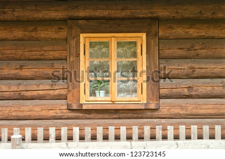 Window of a old wooden cottage. Retro style. - stock photo