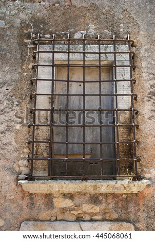 Window of a prison with iron bars