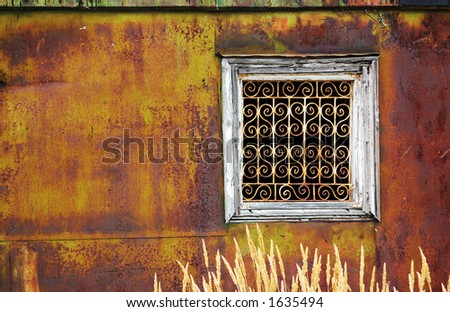 Window of a rusty building - stock photo