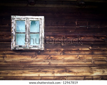 Window of a wooden cottage - stock photo