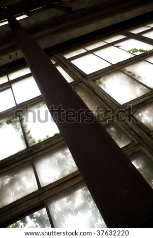 Window of abandoned factory - stock photo