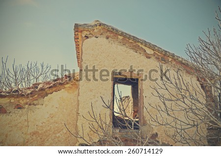 window of an abandoned house - stock photo