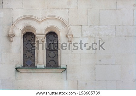 window of an old gothic stone building - stock photo