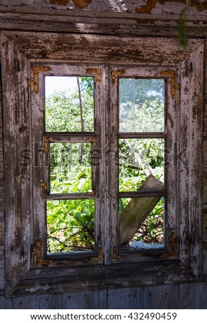 Window of an old ruined wooden house