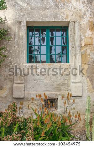 Window of an Santa Barbara Mission building - stock photo