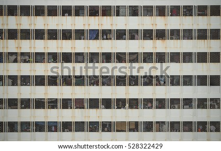 window of old apartment building in the city of asia