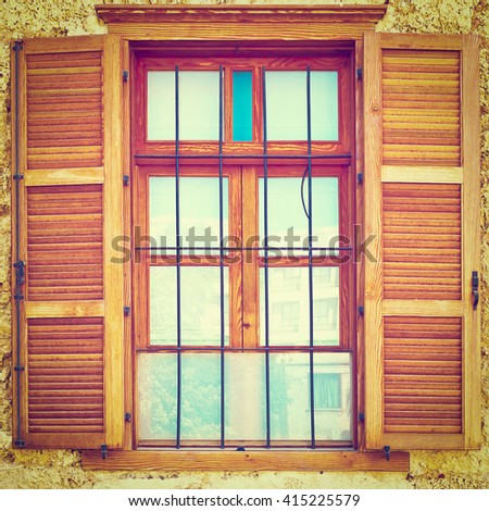 Window of Old Building after Reconstruction in Tel Aviv, Instagram Effect - stock photo