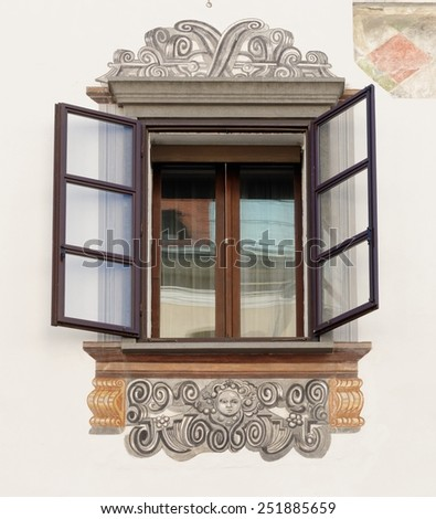 Window of old house in Ljubljana, Slovenia, with murals - stock photo