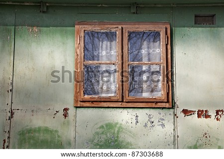 window of old metal house