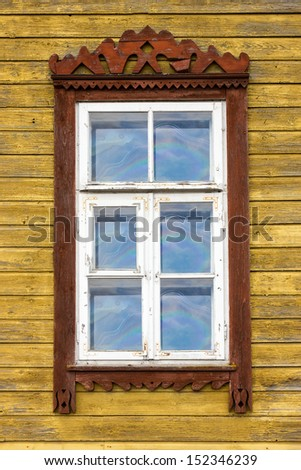 Window of old wooden yellow painted  house