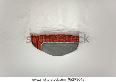 Window of red car totally covered with snow - stock photo