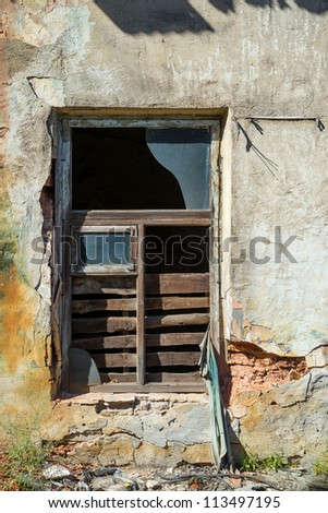 window of the old ruined building - stock photo