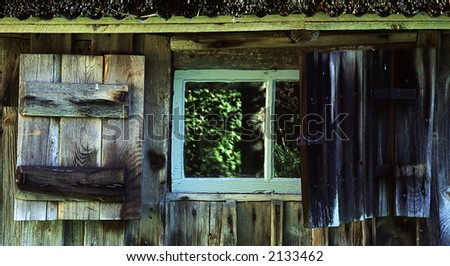 Window on a old cottage - stock photo