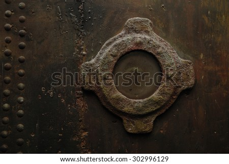Window on a rusty metal wall. Steampunk style